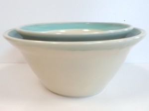 Ten and eight inch wide white porcelain wheel thrown bowls.