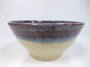 Cone six porcelain wheel thrown bowl.