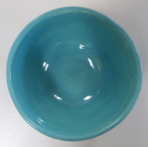 Small bowl slip decorated with aqua slip and glazed with robins egg blue and clear glazes.