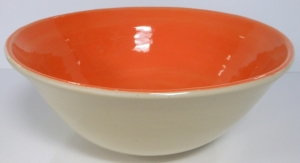 Wheel thrown fruit bowl with orange slip interior and clear glaze.