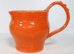 Slip coated and glazed wheel thrown pitcher fired to cone six.