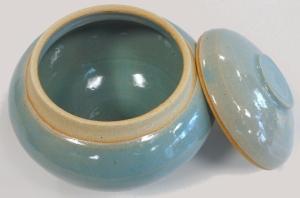 Wheel thrown blue celadon glazed jar with lid.