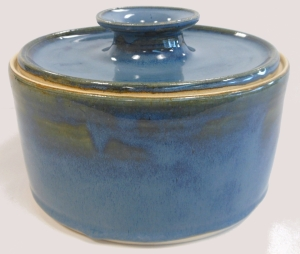 Floating blue glazed covered pottery baking dish.