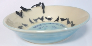 "Hand made bird bath inspired by the rhyme, "" Sing a song of sixpence ""."