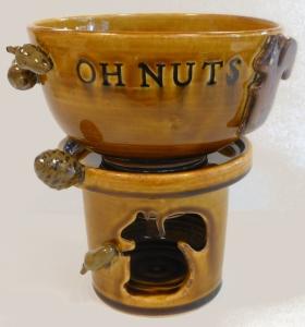 Pottery fondue pot with tea-light warmer.