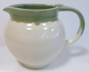Wheel thrown pottery jug glazed with spearmint and antique white glazes.
