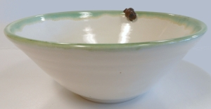 Wheel thrown pottery bowl with small slip-cast acorn.