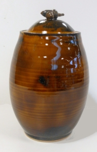 Decorated with chocolate brown under-glaze and top coated with amber glaze.