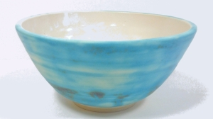 Wheel thrown rice bowl decorated with strontium mat glaze.