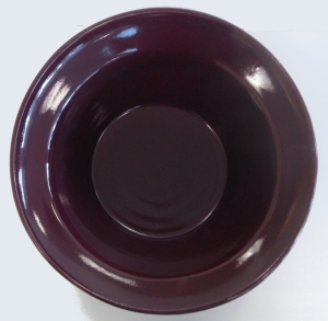 Pottery wheel thrown bowl decorated with purple blue glaze.