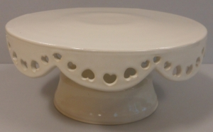 Pottery wheel thrown cake plate  with cut out hearts and glazed with antique white.