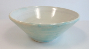 Wheel thrown pottery bowl made with recycled clay and decorated with clear and strontium glazes.