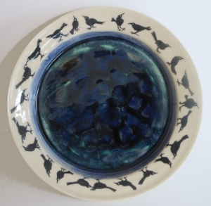 Large service platter with hand painted crows surrounding a pool of reflective glaze.