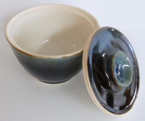 Wheel thrown small pottery bowl for salad dressing.