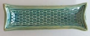 Olive tray with basket weave pattern.