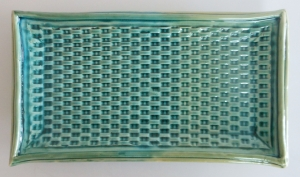 Block formed sushi tray, decoration includes basket weave pattern with hand extruded rim and foot,