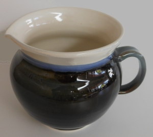 Wheel thrown yogurt making jug with hand pulled handle.