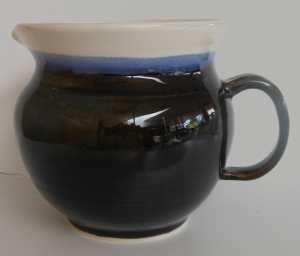 Floating blue and antique white glazes fired to cone six.