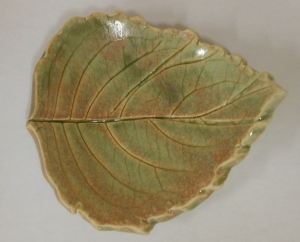 Impressed hydrangea leaf plate decorated with pixie dust glaze.