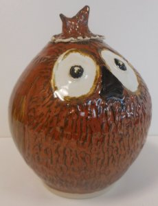 Handmade owl jar glazed with berry rust, black and white glazes.