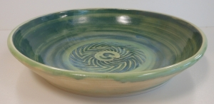 Pottery pasta bowl with chevron and slip decoration.