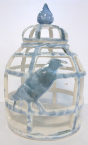 Handmade pottery hurricane lamp in the form of a bird cage.
