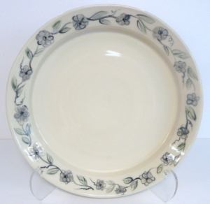 Pottery wheel thrown platter with hand painted black and white flowers and leaves.