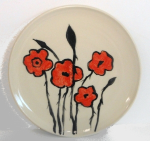 Wheel throw plate decorated with poppies for Remembrance Day.