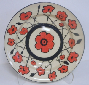 Hand made commemorative pottery serving platter decorated using coloured slips and clear glaze. 100 years since the First world war1914-2014