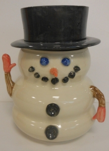 Hand made pottery snowman jar, wheel thrown and colour slip decorated.