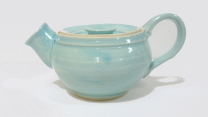 A small wheel thrown  teapot decoratd with mock robins egg blue glaze. A gift for my great niece.