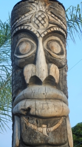 A Hawaiian totem over looking Kahalu'u Bay cultural site found in the resort district of Kona, Hawaii the big Island.