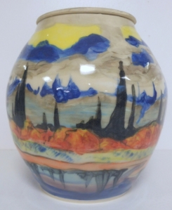 Wheel thrown studio pottery jar hand painted with coloured slips and top coated with clear glaze.