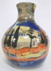Vase with slip decoration of a impressionist Canadian landscape. Hand painted by Frank Mitchell.