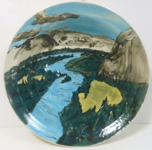 Thirteen inch hand painted fruit bowl with image of the Bow River Valley, Alberta, Canada. Coloured slip on wheel throw vessel.