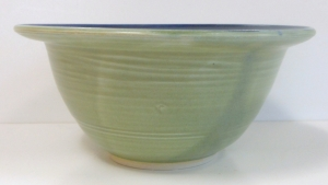 Ten inch wide wheel thrown pottery mixing bowl decorated with spearmint, black and cobalt glazes