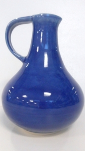 Wheel thrown pottery cruet bottle, twice dipped in  with robins egg blue glaze and cobalt glaze.
