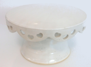 Wheel thrown fretted stoneware pedestal cake plate, glazed with antique white on recycled clay.