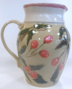 Recycled clay jug decorated with cherries.