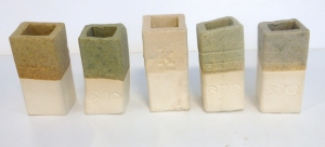 Five different ash glaze tests, fired to cone six oxidation. No colorants added. Base formula ash, nepheline synite, ball clay and dolomite.
