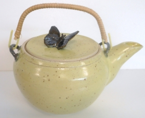 Speckled stoneware teapot with butterfly on lid. Wheel thrown and fired to cone 6.
