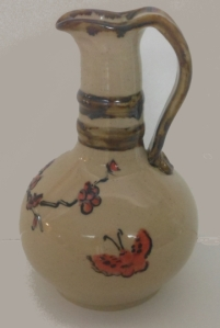 Hand decorated with painted slips and refired with fine liner.
