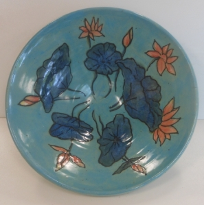 Pottery bowl depicting waterlilies, contours over-glazed with with fine liner.