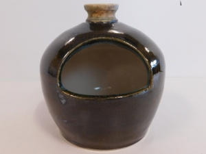 A small domed salt pot decorated with palladium and ash  glazes. Kiln fired to cone 6