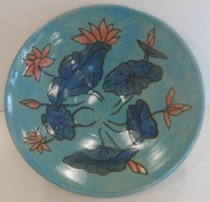 A large hand-painted bowl depicting waterlilies.