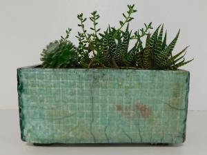 A small handmade raku fired planter.