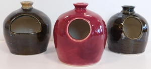 Three wheel thrown pottery salt pigs