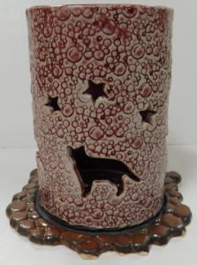 Cat cut out hurricane lamp with stars. Handmade with M370 clay body and glazed in vintage rose.